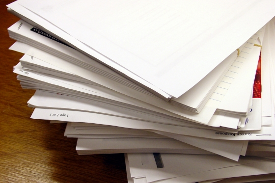 A stack of paper reports.